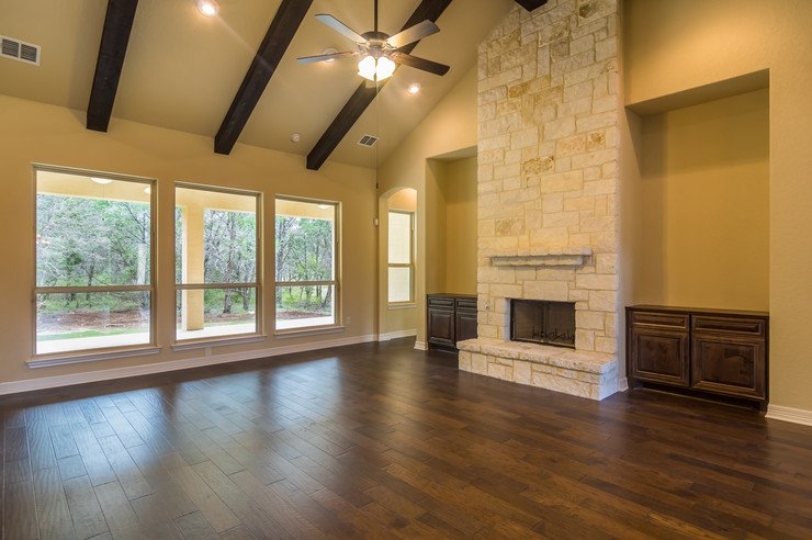 Living area w/ opt. fireplace stone to ceiling \u0026 beams